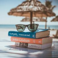 A stack of books at a beachside cabana