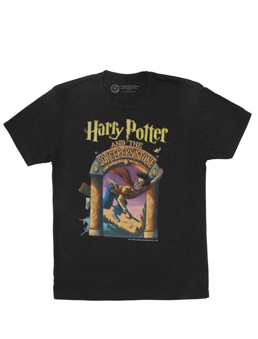 Black unisex-cut T-shirt.  On the front is a large image of the Harry Potter and the Sorcerer's Stone cover