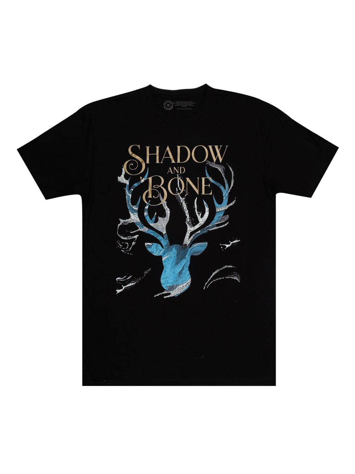 A black crew neck t-shirt with cover art elements from Shadow and Bone by Leigh Bardugo