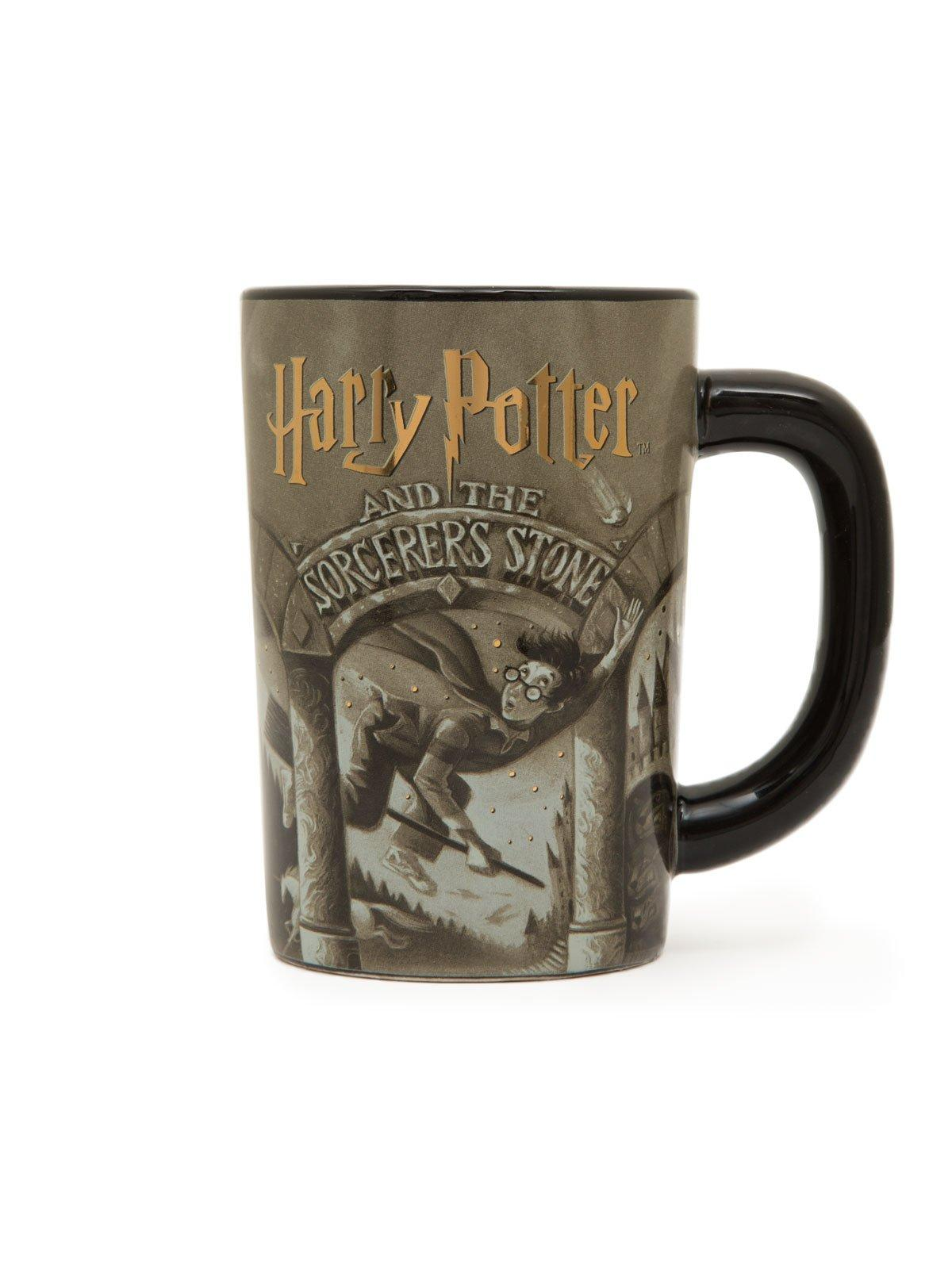 A ceramic coffee mug featuring the cover art (by Mary GrandPre) of Harry Potter and the Sorcerer's Stone by J. K. Rowling
