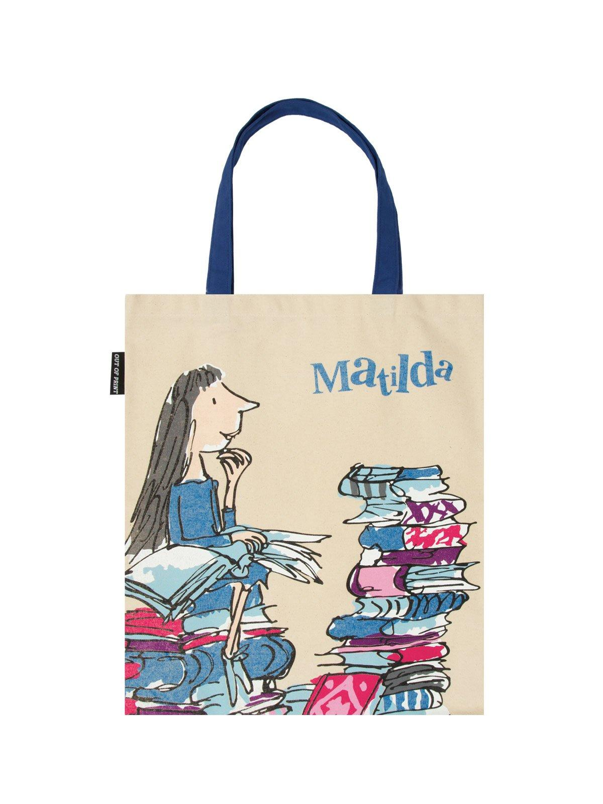 An off-white canvas tote with blue handles, featuring cover art (by Quentin Blake) from Roald Dahl's book Matilda