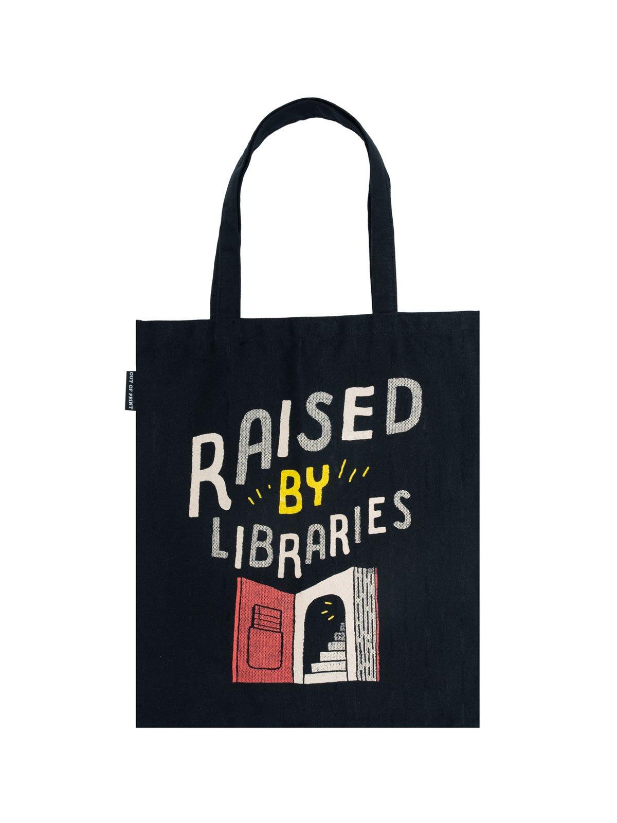 """Black canvas tote bag with handles.  The design on the front says """"Raised by Libraries"""" in white and yellow text with an open book below"""